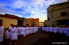 People from Cabras dressed in white for their Patron Saint befor starting to run towards the sanctuary of Saint Salvatore situated seven miles from Cabras, a fisherman centre...  by  Loi Salvatore