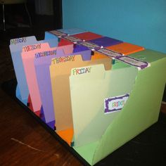 DIY classroom daily organizer: magazine boxes from IKEA, paint, matching file folders, binder clips, labels, printer, & a boot tray from Lowe's. A plastic version retails for $50, I made this for less than $15!