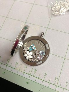 Building My Locket! Lets build yours  www.SparklingLockets.com   This is so too cute.
