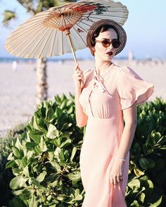 I love the 1920's - would like to wear this style every day, but I know it doesn't suit me very well as 1950's suits me better. I'm also afraid of cutting my hair shorter into a flapper bob. Anyway, I feel great wearing this style from time to time. Vintage rose dress and burgundy lips
