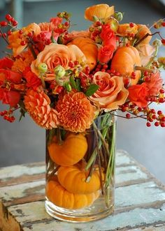 fall arrangement with pumpkins, dahlias, roses & berries. #gardening