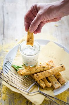 A simple stick of chickpea polenta flavored with rosemary, passed in corn and fried.  Sauce made with yogurt and chives.