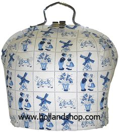 Dutch Tea Cozy - These are awesome! It completely encloses the teapot so that no heat escapes. To pour the tea, you open the latch at the top and lift the teapot out. . . and you'd better have a pot holder handy, because the teapot handle will be HOT!! My Mum had one of these.