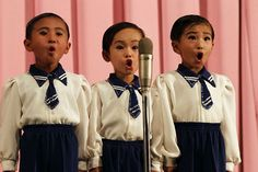 the girl in the middle is probably how I look when I sing in my car and think no one is looking.