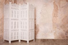 Add privacy and elegance to any room with a folding screen divider.
