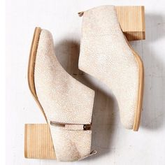 """UO Cooperative Ariel ankle booties size 9M BNIB. These booties were bought at Urban Outfitters and never used. Fit is very true to size. Low-cut ankle boot in scaly, shimmery peach leather. Complete with a side zip closure and pull-tab at the heel. Propped up on a stacked 2.5"""" wood heel and rubber sole. I have my own pair of these and they are super comfy! Cooperative Shoes Ankle Boots & Booties"""