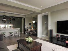 Lakás amerikai stílusban, kellemes szürkészöld színekkel, üvegfalú dolgozószobával