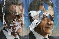 Torn election posters of French President Nicolas Sarkozy in Paris, May 6, 2012. (Francois Mori/AP)