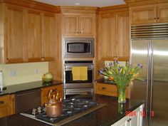 Prestige Kitchen Cabinets stained cabinetry, paneled walls, mini bar | stained kitchen