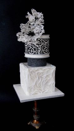 That bottom tier! Lace, geometric ruffles, sugar flowers and elegantly-shaped tiers make this black and white cake a stunner. Black And White Wedding Cake, Black Wedding Cakes, Unique Wedding Cakes, Beautiful Wedding Cakes, Gorgeous Cakes, Wedding Cake Designs, Fondant Cakes, Cupcake Cakes, Bolo Cake