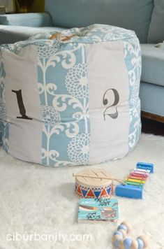 Copycat Land of Nod Floor Pouf Tutorial | Ciburbanity featured on Remodelaholic.com