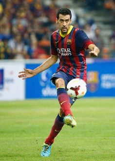 Sergio Busquets of Barcelona FC kicks the ball during the friendly match between FC Barcelona and Malaysia at Bukit Jalil National Stadium on August 10, 2013 in Kuala Lumpur, Malaysia.