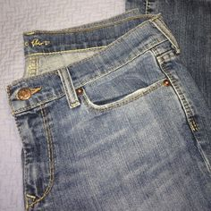 Old Navy the Flirt Mid-rise, boot cut Jean. Medium wash, regular length with slight stretch. Perfect condition! Old Navy Jeans Boot Cut