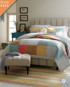 I heart this quilt-- big squares, beautiful colors, and perfect against a very neutral background