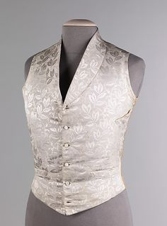 Wedding vest Date: third quarter 19th century Culture: American Medium: silk, cotton, leather Dimensions: Length at CB: 24 in. (61 cm) Credit Line: Brooklyn Museum Costume Collection at The Metropolitan Museum of Art, Gift of the Brooklyn Museum, 2009; Gift of Mrs. Townsend Russell, 1925 Accession Number: 2009.300.616