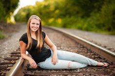 high school senior on railroad tracks - Tavia Larson Photography - Boiling Springs Photographer