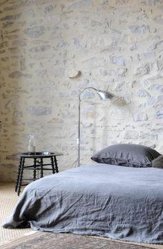 studio interir wall idea...use the local stones and limewash