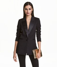 Black. Tuxedo jacket in woven fabric with satin lapels. Chest pocket, welt front pockets with satin trim, and vent at back. Satin-covered button at front
