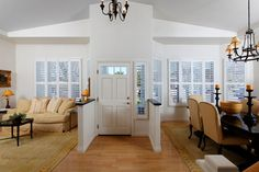 Front Door Opening Into Living Room The Opens A Foyer Adjacent To Cozy With Marble Surround Fireplace And Formal