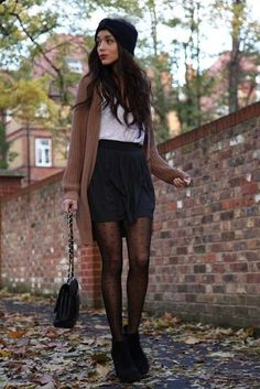 Master the effortlessly chic look in a brown knit cardigan and a black pleated mini skirt. Black suede booties will add a touch of polish to an otherwise low-key look. Shop this look for $96: http://lookastic.com/women/looks/ankle-boots-crossbody-bag-tights-mini-skirt-v-neck-t-shirt-cardigan-scarf/4217 — Black Suede Ankle Boots — Black Leather Crossbody Bag — Black Polka Dot Tights — Black Pleated Mini Skirt — White V-neck T-shirt — Brown Knit Cardigan — Black Scarf