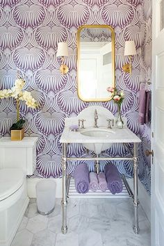 Farrow and Ball wallpaper, purple stands out. Balanced with white nice