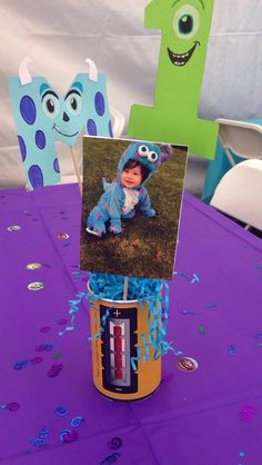 Monsters inc centerpieces I made. Every table had a different picture of him in his sulley costume