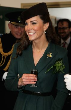 Catherine, Duchess of Cambridge holds a glass of Harvey's Bristol Creme in the Junior's Mess as she visits Aldershot Barracks on St Patrick's Day on March 17, 2012 in Aldershot, England.