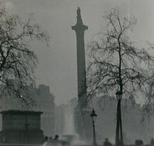 """December 4, 1952 – Great Smog of 1952: A """"killer fog"""" descends on London (in the process coining the word """"Smog"""", for """"smoke"""" and """"fog"""").      Nelson's Column during the Great Smog of 1952"""