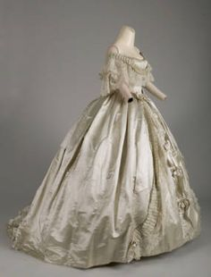 Evening dress, 1861. Silk satin, silk ribbon, hand-made point de gaze lace. Attributed to Worth & Bobergh, France.