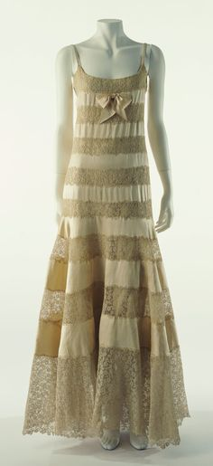 "Evening Dress, Chanel, ca. 1930, alternately-pieced silk satin and lace.  ""Of the camisoles, slip dresses, and other similar styles that have transformed to become modern day outerwear, this work was the first such underwear fashion piece of the modern era..."""