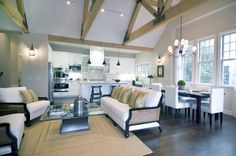 modern barn homes | Living room in a modern farm house by Meredith Baer with truss-beamed ...