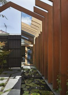 FMD Architects reform a home with wood cross stitches #WoodLovers #architecture #house