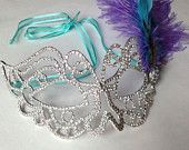 Rhinestone mask, princess mask, gemstone mask, sparkly mask, glitter mask, silver mask, teal ribbon, teal feather, lilac father, lavender feather, purple feather, gem mask, rhinestone mask, unique mask, renaissance mask, mardigras mask, fat tuesday mask, unique, mask, mardi gras, red, bedazzled mask, etsy mask, beautiful mask, ornate mask, elegant mask,   Mask by: Renee Prows Etsy Store: rprows