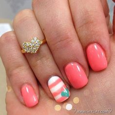 This cute nail design features an elegant stripe design on the ring finger and a super pretty coral color on all the other nails! Enjoy!
