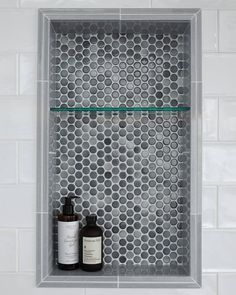 Featuring a decorative tile in a recessed shelf adds functionality and beauty to the space. This penny round tile has a cloudy color scheme of cool grays and blues. Plus, layering two pencil trim pieces makes this detail especially eye-catching! Shower Floor, Decor, Bathroom Trends, Bathroom Inspiration, Round Tiles, Penny Tiles Bathroom, Feature Tiles, The Tile Shop, Shower Floor Tile