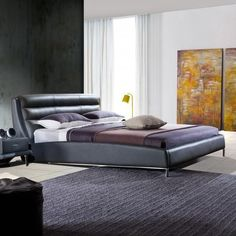You'll love the sleek curvature and contemporary design of this contemporary upholstered bed. The attractive and charming platform bed provides both comfort and relaxation in an attractive design.