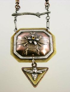 Nancy L. T. Hamilton: bee necklace; sterling silver, PMC (fine silver clay), copper, brass, citrine; soldered, sawn, riveted, chased, repousse, hydraulic press.