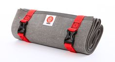 Ultralight Travel Yoga Mat by YOGO - Folding Mat With Integrated Straps and Handle for Carry and Wash. The best travel yoga mat ever made, packs to 12î and weighs just over 2 lbs. Folds small, secures, and fits in small bags. Folding design keeps mat clean, use attached straps straps to wash then hang to dry in the shower. Slim natural rubber has super high-grip performance rubber, even with mild perspiration. Eco: super sticky natural tree rubber, one tree planted per mat in Africa.