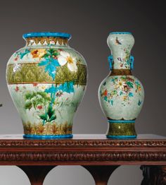 "Large earthenware vases with polychrome decoration of flowers & foliage on a celadon background. Features ""Bleu Deck"" glaze. Théodore Deck, about 1870-1880"