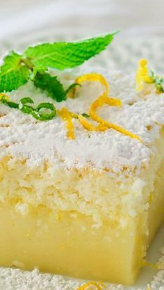 Lemon Magic Cake// 4 eggs (separate yolks from whites) at room temp 1 t vanilla extract 3/4 c sugar 1 stick  butter, melted ¾ c all purpose flour 1¾ c milk-warm ¼ c fresh lemon juice zest from one lemon powdered sugar to garnish Whip egg whites, whip yolks with sugar, add rest, bake in 8x8 dish @325 for45-70 min. Dust with powdered sugar