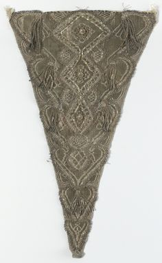 Stomacher, early 18th century. Silver silk with metallic threas embroidery.