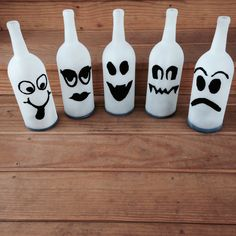 My wine bottle ghosts! First I cut the bottoms off, spray painted them with frosted glass paint, cut the faces out of black felt and then glued them up there! At night I will have an electronic tea light candle underneath them so they will glow! Also since the edges were sharp I wrapped black masking tape around the bottoms so I would not cut myself (again). I love them. #winebottles #ghosts #halloween #crafts