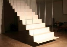 Mondial  Ductal concrete stairs - amazing to get concrete to be formed this thin on a structural element like a staircase