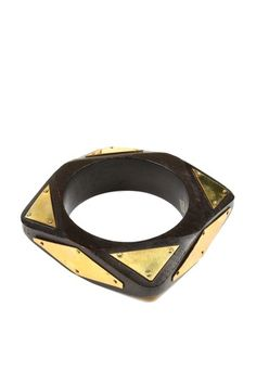 "Called the ""Aerosmith Bangle"" - wood with 18K gold plates. Getting it to make my inner 80's hairband girl happy!"
