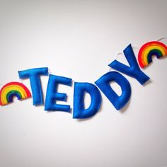 A rainbow custom name bunting /garland /wall hanging, stars and custom name garland / bunting