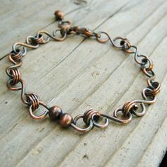 Antiqued Copper Charmer bracelet. $18.00, via Etsy.