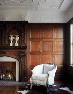 Wood paneling. Antique furniture pieces mixed with some modern.