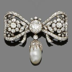 A diamond and pearl bow brooch,