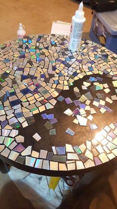 CD Mosaic Table is part of Cd diy CD Mosaic Table We were going to throw out a bunch of old CD& when I remembered we had this coffee table sitting on the back porch gathering dust Very happy wit - Cd Mosaic, Mosaic Crafts, Mosaic Projects, Diy Projects, Mosaic Mirrors, Mosaic Birdbath, Project Ideas, Cd Diy, Home Crafts