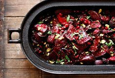 Moroccan Roasted Beets with Pomegranate- beets and balsamic glaze tossed with pomegranate seeds and pistachios, served warm makes for a hearty side dish. Save the leftovers and toss with greens for a lovely winter salad, during the week. / Wholesome Foodie <3